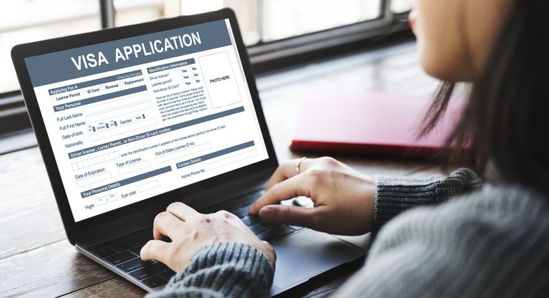 Woman applying for Canadian visa on her laptop