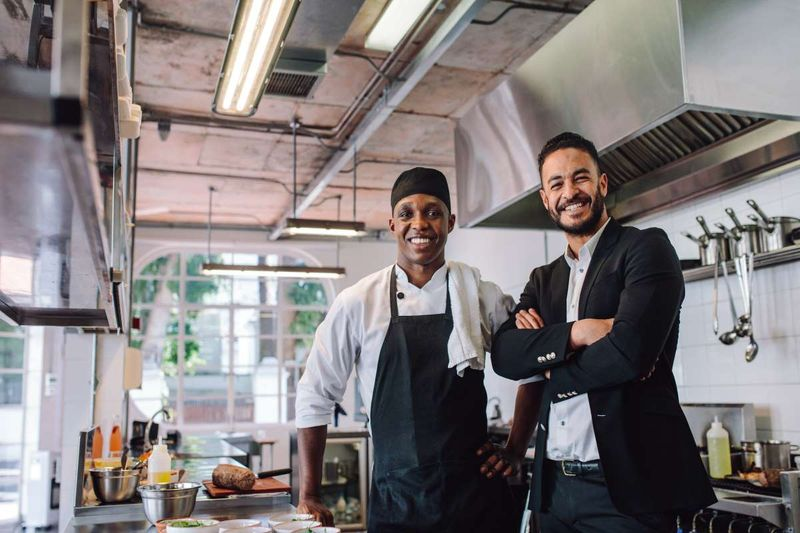 African American chef and Muslim business owner in restaurant | business immigration to Canada