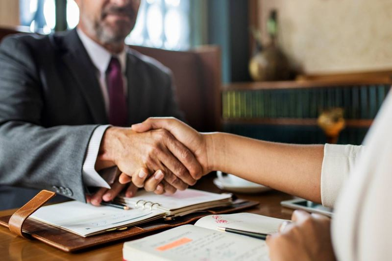 man shaking hands with women   jobs in Canada
