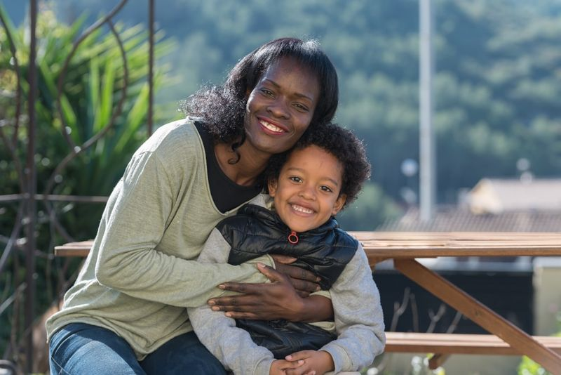 African American mother and son hugging thanks to Canada immigration support.