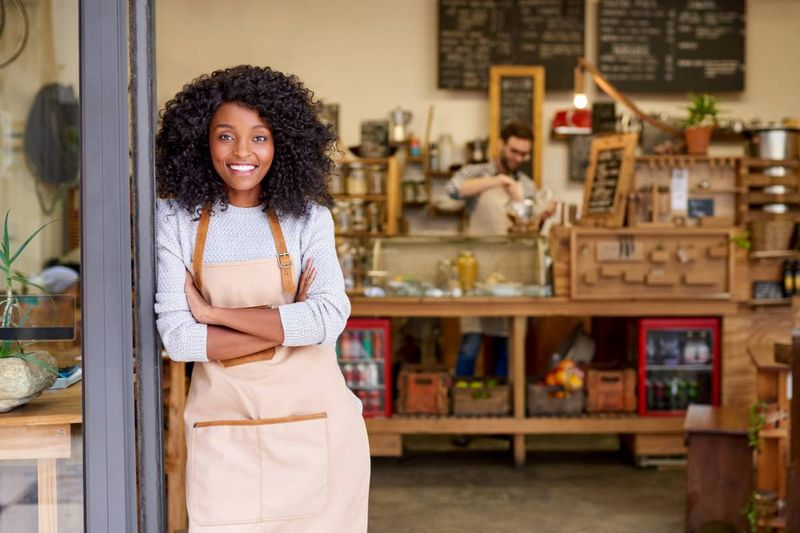 African-american small business owner infront of coffee shop |  how to apply for a Canadian visa from Kenya
