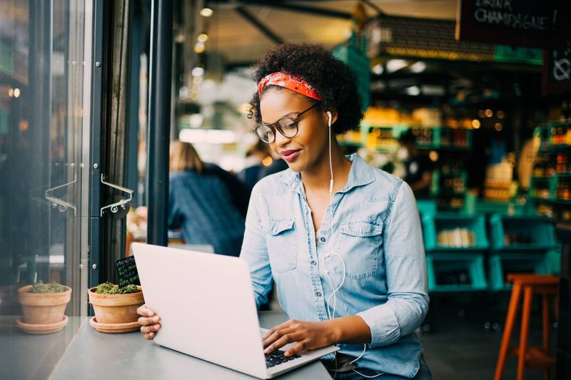 african-american-woman-typing-on-laptop | how to apply for a Canadian visa from Kenya