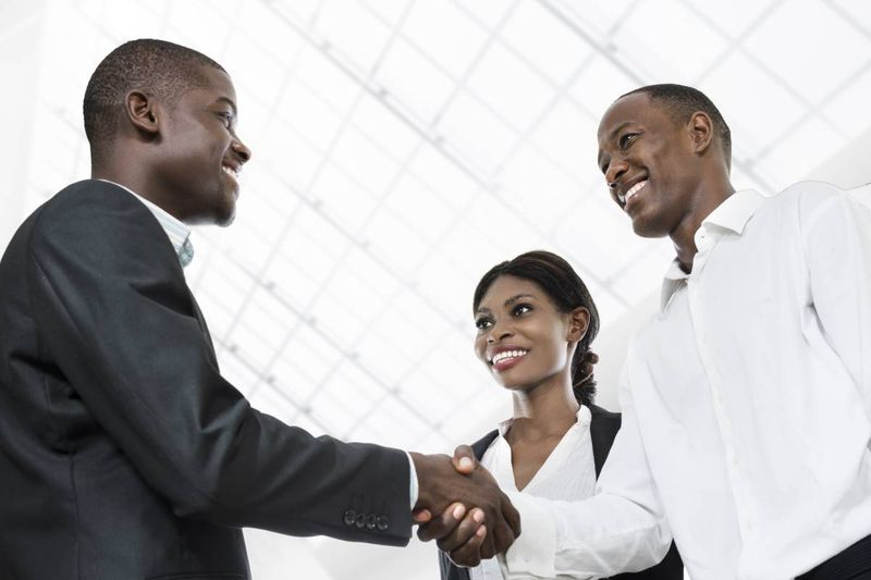 African business people shaking hands |  how to apply for a Canadian visa from Cameroon