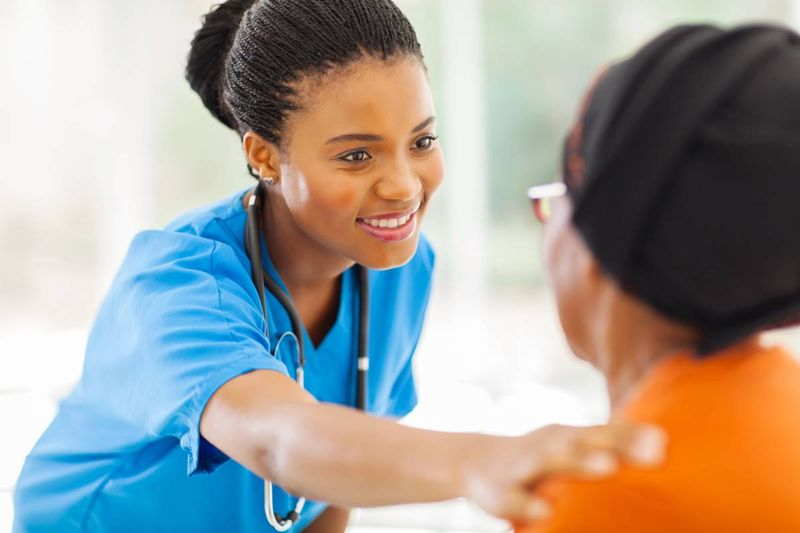 African nurse helping elderly patient |  jobs in Canada