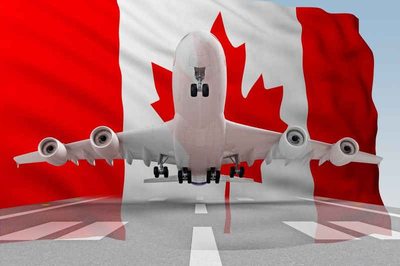 airplane take off in front of Canada flag | Canada immigration