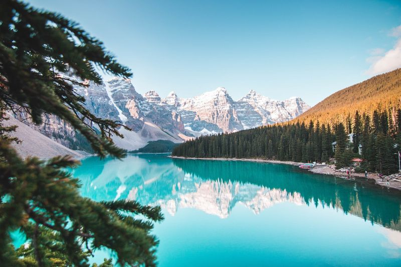 Beautiful view of Moraine Lake surrounded by mountains and tress in Alberta Canada