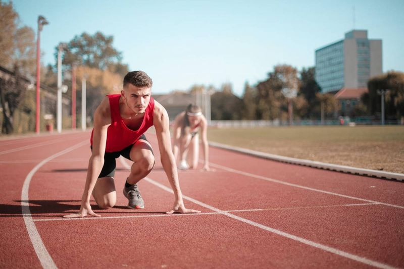 athlete wearing red on race track | immigrate to Canada