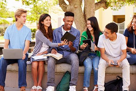 university students sitting outside