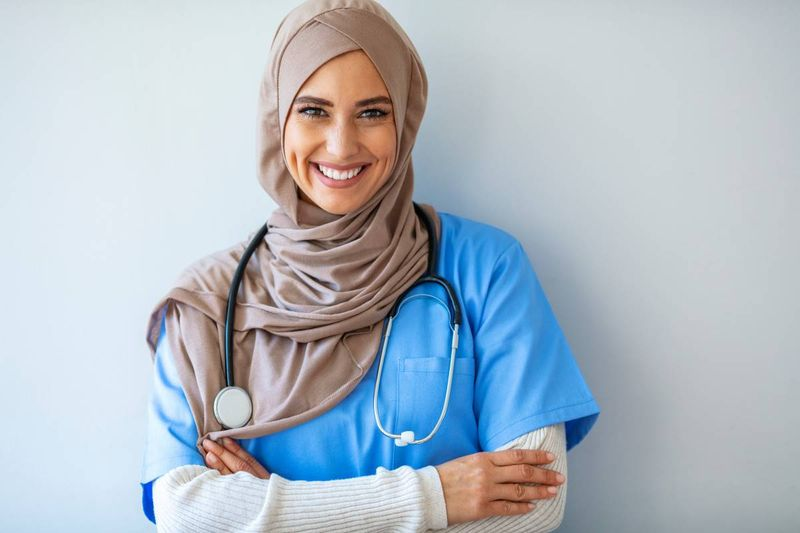 attractive female doctor smiling | immigrate to Canada