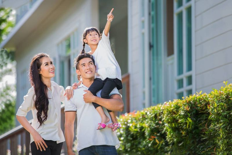 Beautiful Asian family at their new house