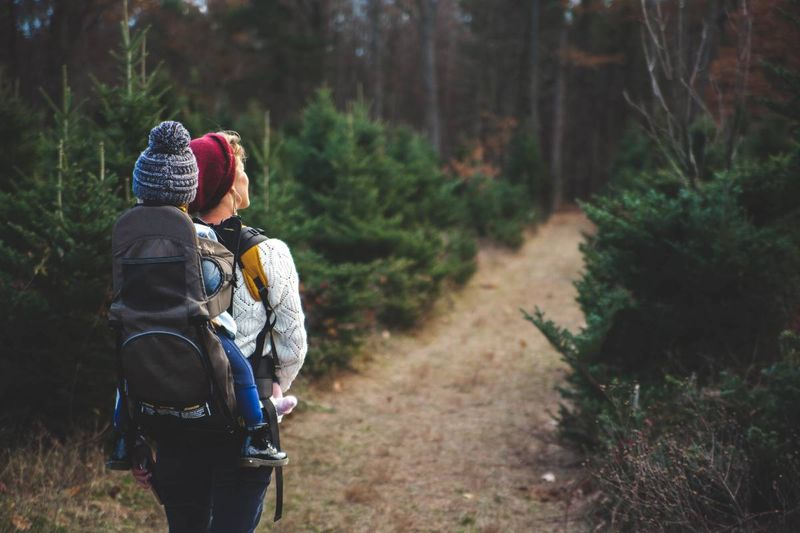 Why Canada | blond haired woman in white long sleeve hiking in Canada visa application