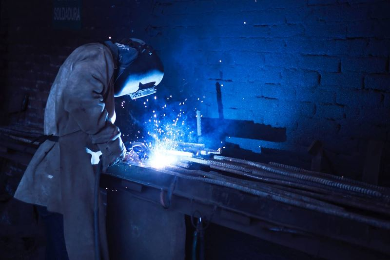 welder in workshop blue flame after migrating to Canada