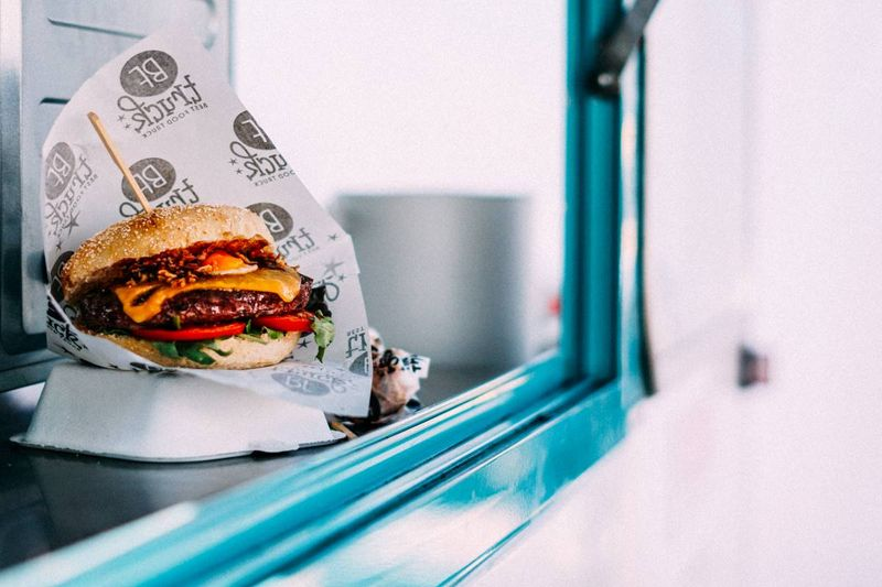 burger on food truck counter | business immigration to Canada