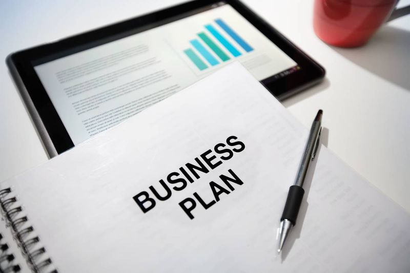 business-plan-with-pen-i-pad-and-coffee-cup | business immigration to Canada
