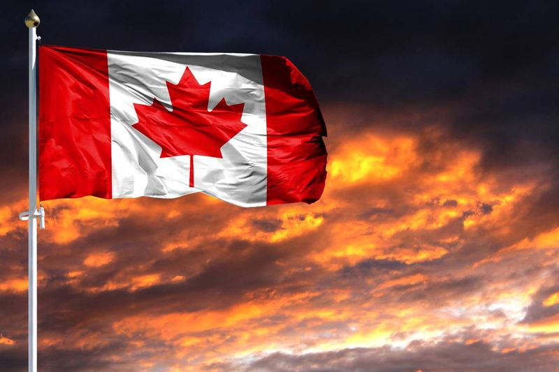 Canada flag at sunset |  how to apply for a Canada visa from Cameroon