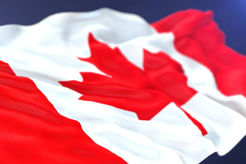 Canada flag on blue background |  how to apply for a Canadian visa from Qatar