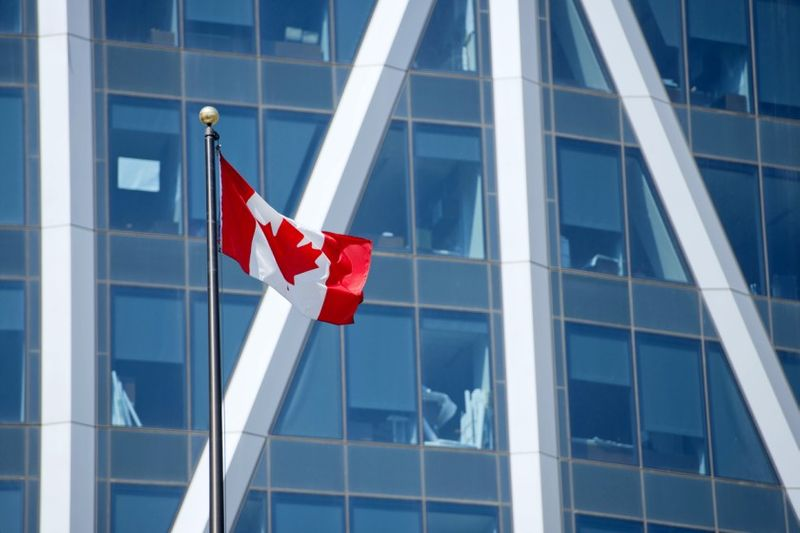 canadian flag with city backdrop