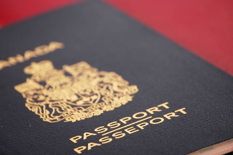 red passport on red background | immigrate to Canada in 2020