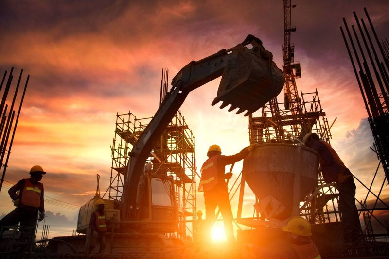construction workers on site at sunset | work in Canada