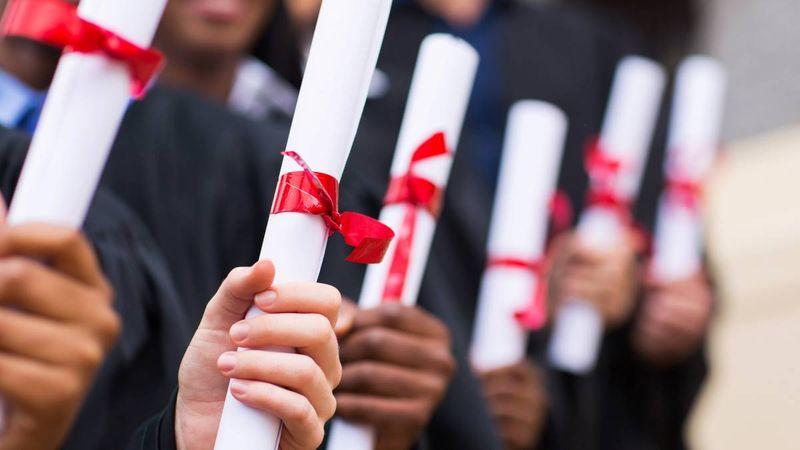multicultural graduates holding diplomas   study in Canada