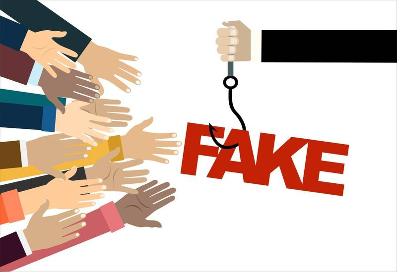 hand reaching for fraud job offer in Canada | fake or real