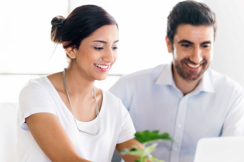 Turkish couple applying for a Canada visa online from laptop| how to immigrate to Canada from Turkey