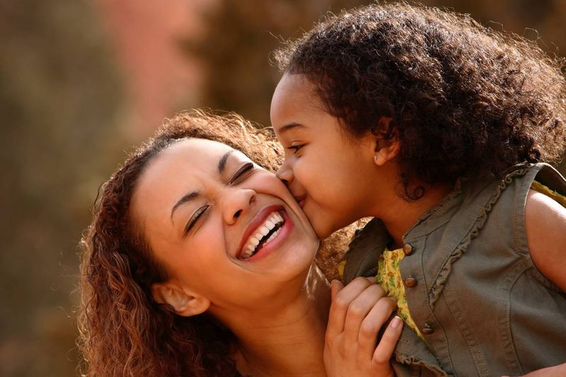 happy-African-American-mother-with-daughter-kissing-her-on-the-cheek | how to apply for a Canadian visa from Kenya