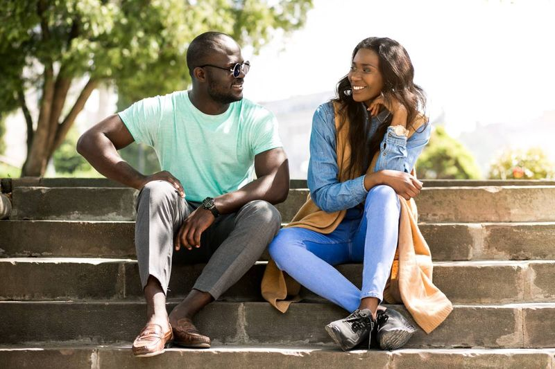 happy african american couple in park |  how to apply for a Canada visa from the Ivory Coast