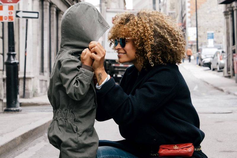 Beautiful ethnic mother with child | how to apply for a Canadian visa from Italy