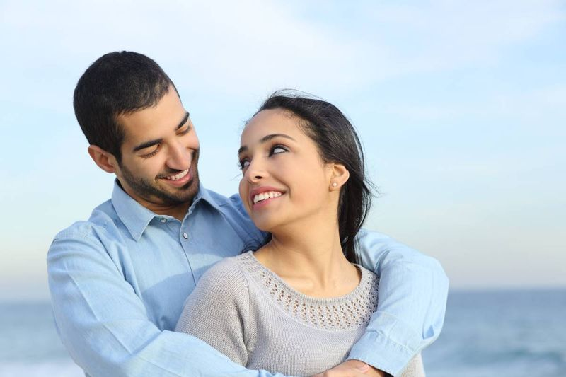 happy Lebanese couple holding each other | immigrate to Canada from Lebanon