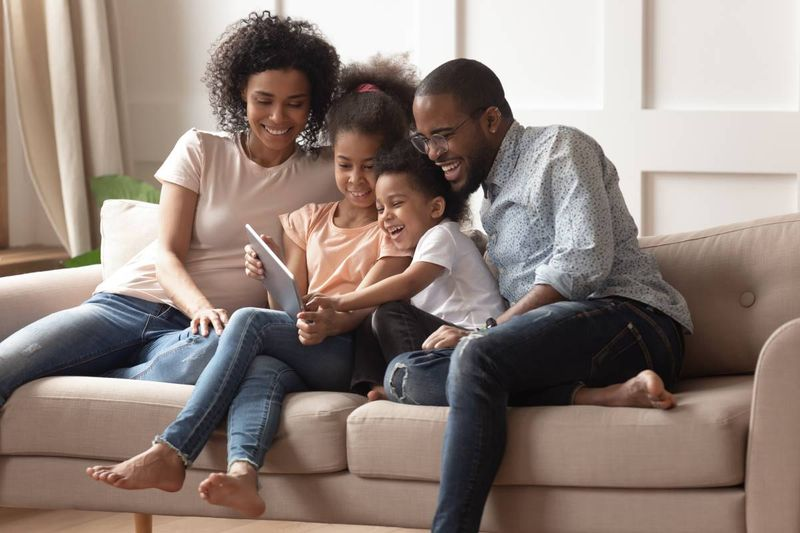 happy-black-people-sitting-on-couch-with-ipad| apply for a Canadian visa from Kenya