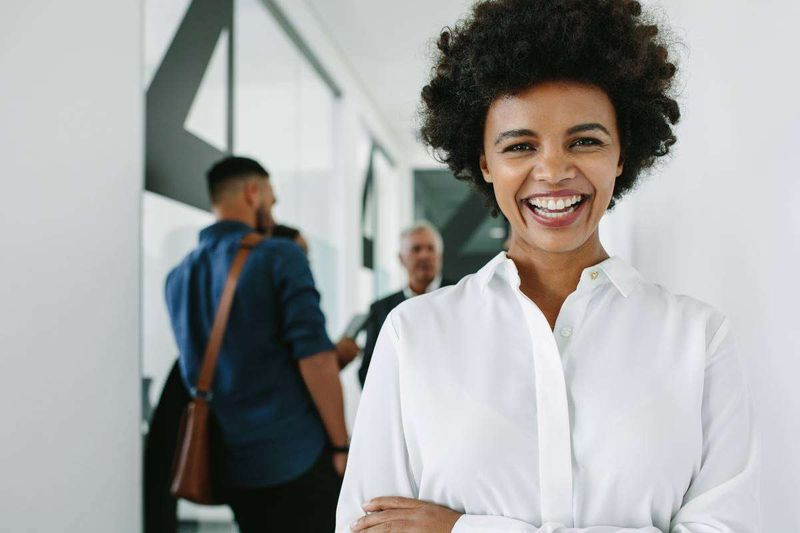 smiling professional woman after successful meeting  | immigrate to Canada