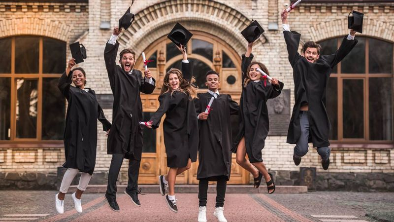 happy-celebrating-multiracial-students-jumping-in-air-after-graduating   International students in  Canada