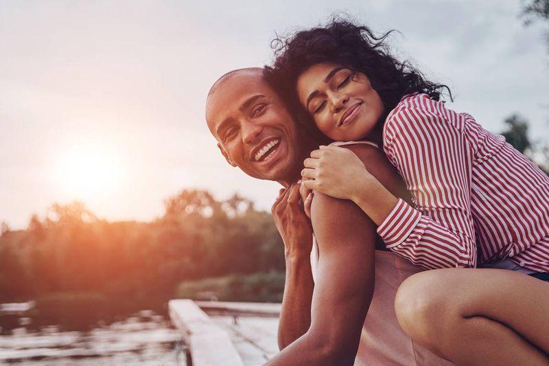 happy couple at the lake | spousal sponsorship Canada