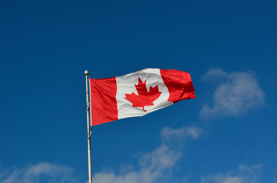 Canadian flag high in the sky