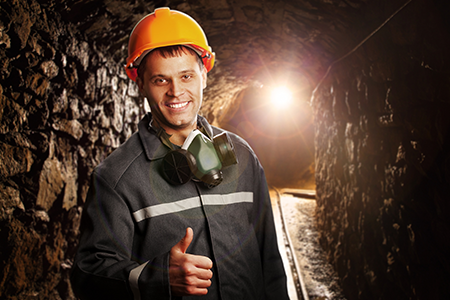 Mine worker with the thumbs up sign