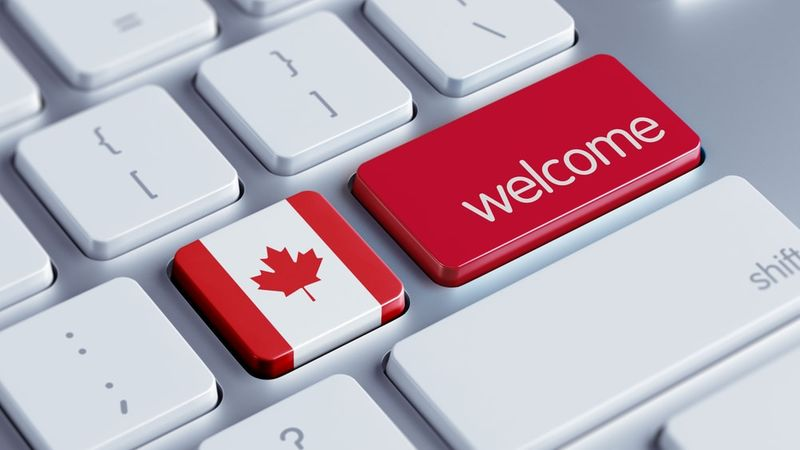 keyboard with Canadian flag and red welcome key