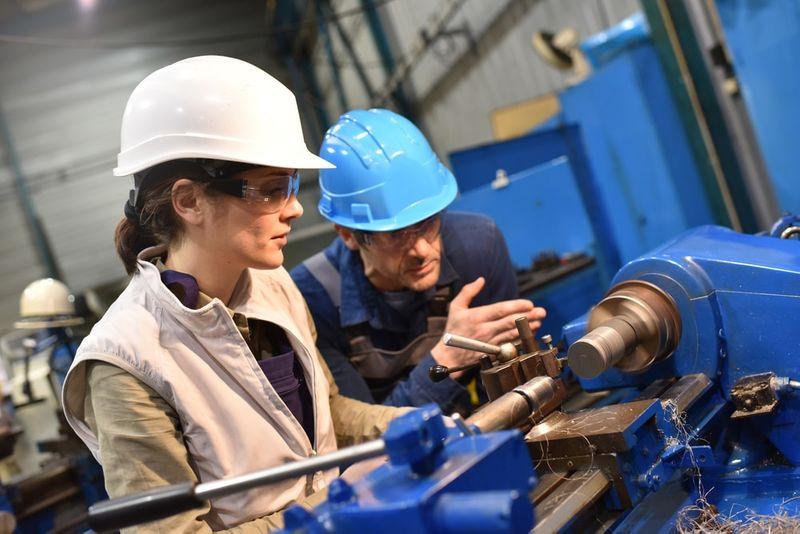 laborer working-on welding machine in Canada