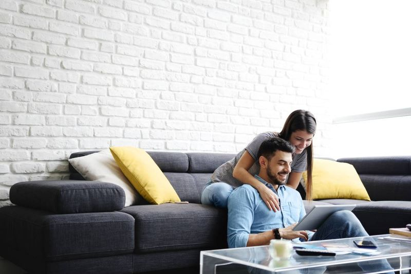 Happy latino couple in new home after they migrate to Canada