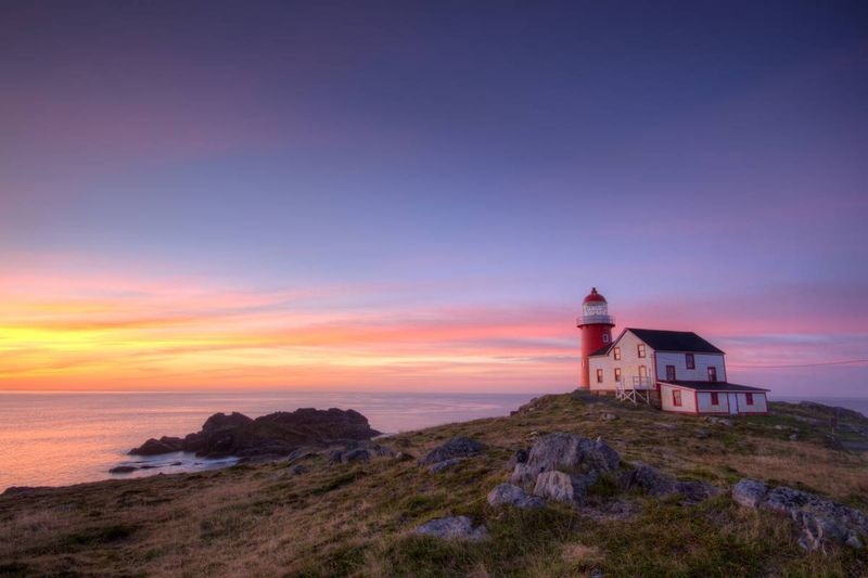 lighthouse at sunset in Atlantic Canada  | Fastest Ways to Immigrate to Canada