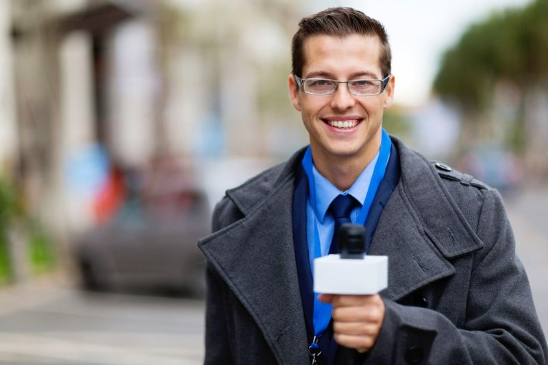 Work as reporter with a Canadian Work Permit.
