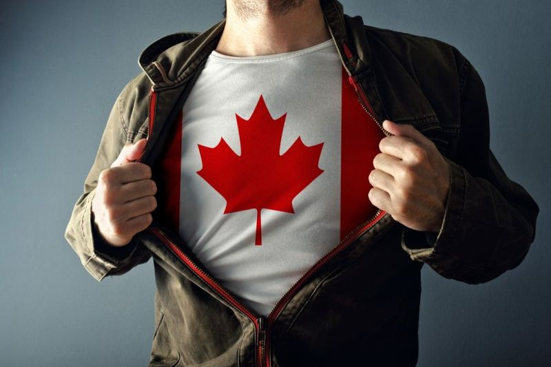 man showing Canadian flag under his shirt