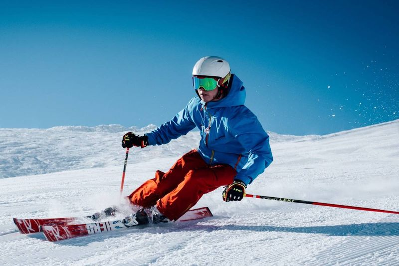 man skiing on slopes in canada working holiday visa