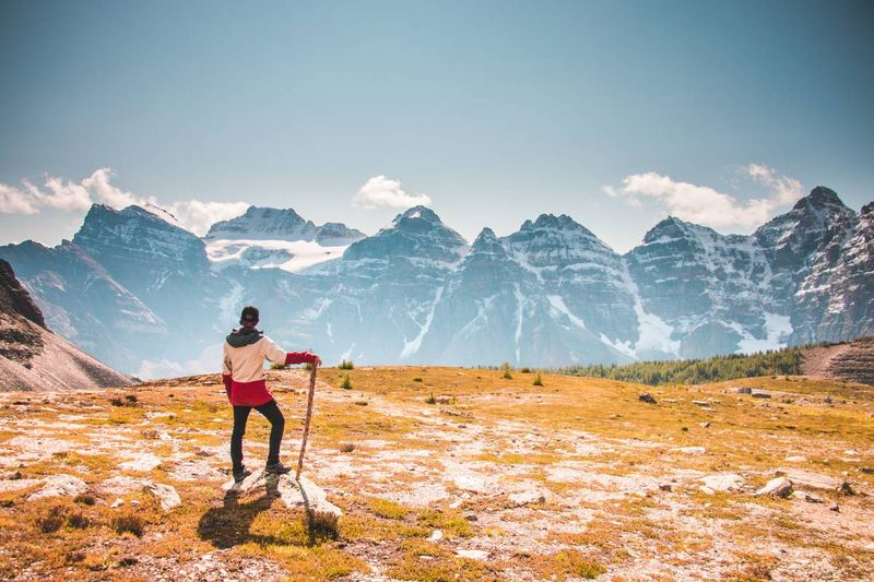man standing looking at Canadian Rockies mountains