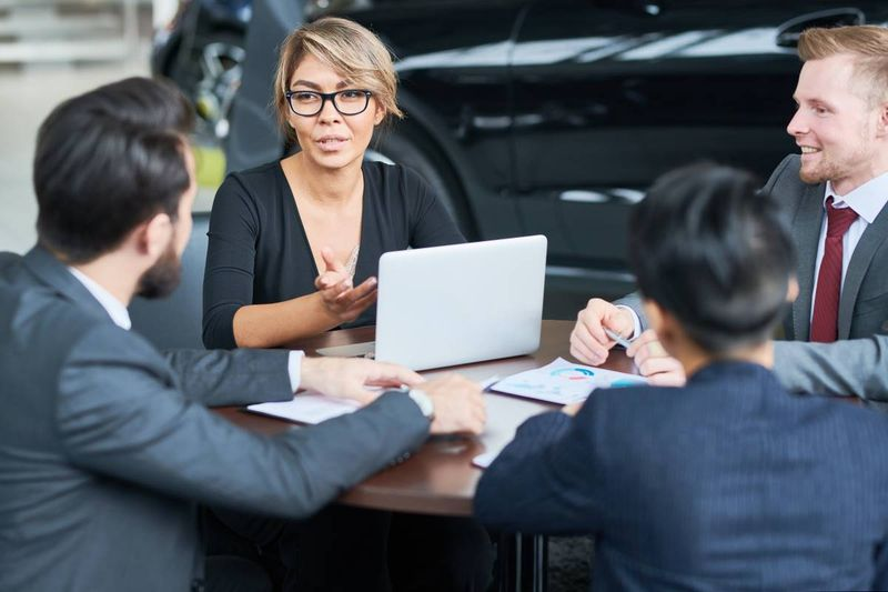 multi-ethnic-sales-team-with-sales-manager-at-car-dealership   Canada Express Entry
