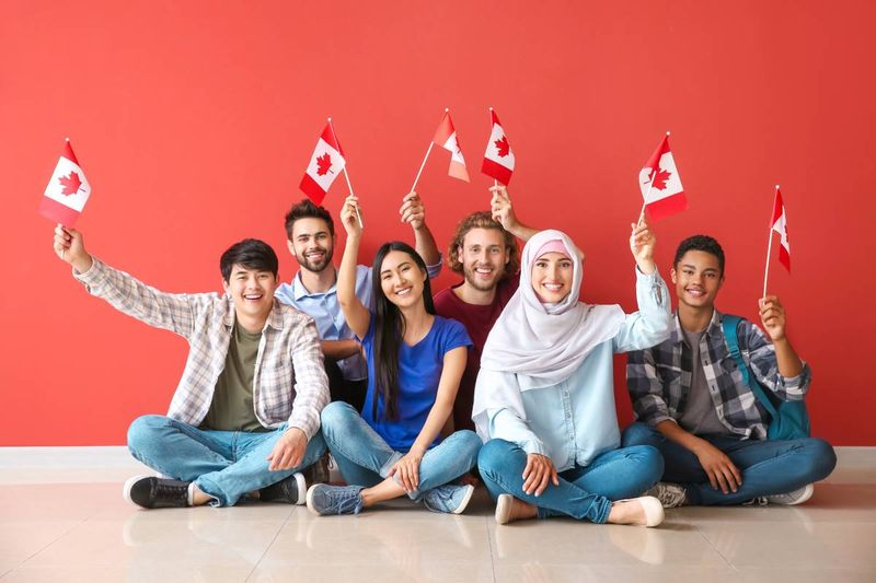 multi-racial-people-holding-canadian-flags