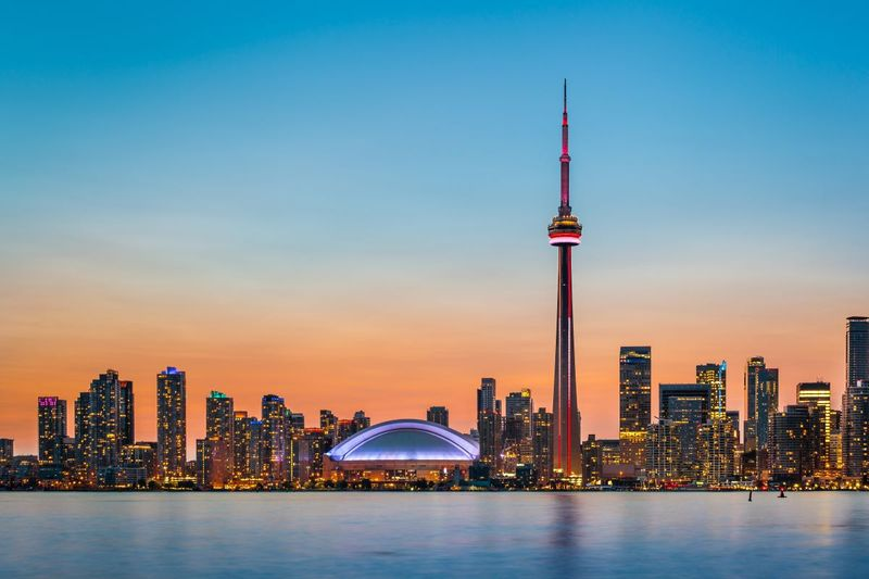 Ontario skyline at sunset Canada lake buildings | immigrate to Canada