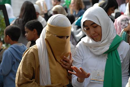 Two Muslim women wearing a burca