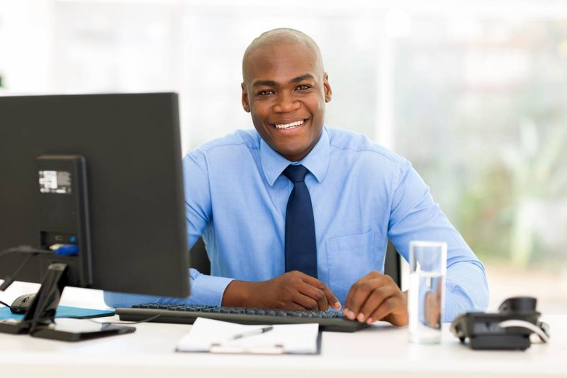 smiling African American business administrator | immigrate to Canada