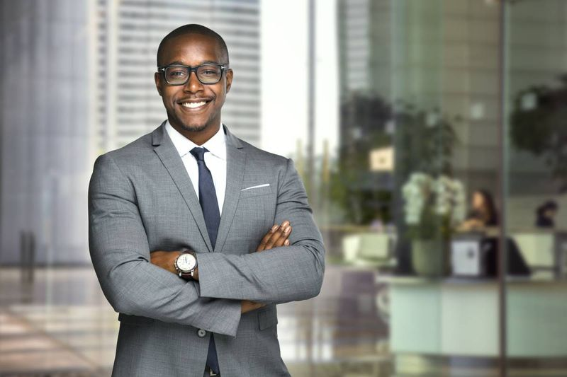 smiling business manager after immigrating to Canada